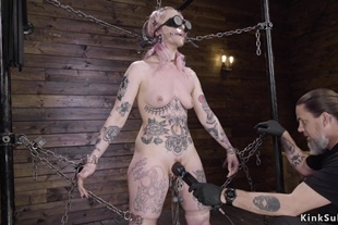 Alt blonde slave isrestrained by chains