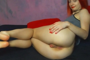 redhead model spreads pussy and show feet