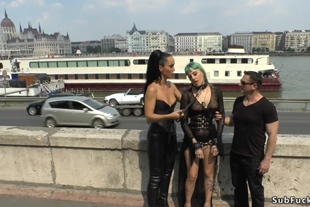 Mistress in leather makes slave fuck in public