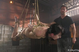 Tattooed suspended slave is caned